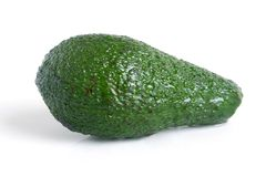 Avocado. Covered dew on the white background Royalty Free Stock Photos