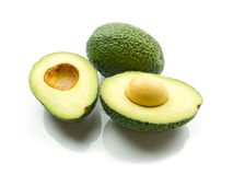 Avocado. S on white background with shadow stock images