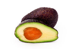 Avocado. The cut fruit of avocado on a white background Royalty Free Stock Photography