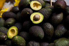 Avocado. Some avocado wholes and halves royalty free stock image
