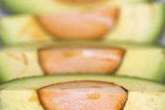 Avocado. Cut avocado on white background , tropical fruit Royalty Free Stock Images