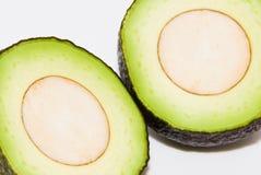Avocado. Cut avocado on white background , tropical fruit Stock Photos