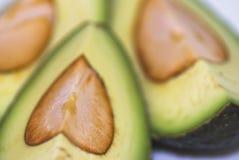 Avocado. Cut avocado on white background , tropical fruit Royalty Free Stock Photo