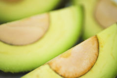 Avocado. Cut avocado on white background , tropical fruit Royalty Free Stock Photography