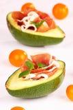 Avocado. Fresh avocado with ham and tomatos stock images