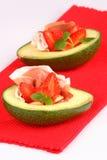 Avocado. Fresh avocado with ham and strawberry stock image