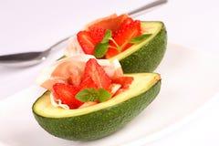 Avocado. With fresh strawberry and ham stock image