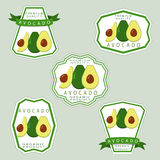 The avocado. Abstract vector illustration logo for whole ripe vegetables avocado with green stem leaf cut sliced.Avocado drawing consisting of tag label bow peel Royalty Free Stock Photos