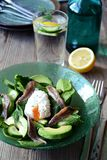 Avocado and anchovy salad. On the wooden background Royalty Free Stock Photos
