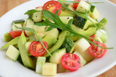 Avocado argula leave salad with cherry tomato vinaigrette dressing Stock Image