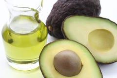 Avocado and avocado oil. Two fresh avocado and avocado oil on white background stock images