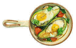 Avocado baked with egg. On ceramic serving pan Royalty Free Stock Images