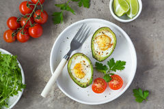Avocado baked with eggs. Top view royalty free stock photos