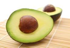 Avocado on bamboo mat Royalty Free Stock Photos