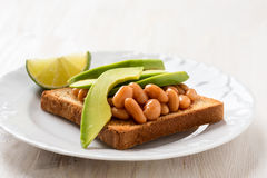 Avocado and beans on toast Royalty Free Stock Images