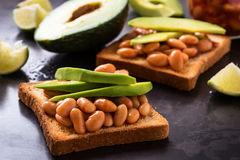 Avocado and beans on toast Stock Photography