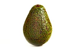An avocado on a white table. stock images