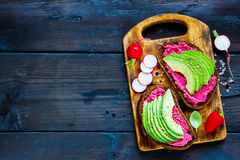 Avocado and beet sandwiches Stock Image