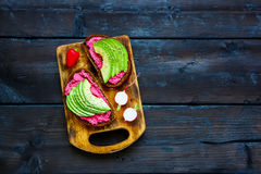 Avocado and beet sandwiches Stock Photo