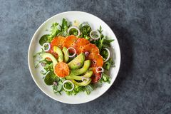 Avocado Blood Orange Salad Over Mixed Greens royalty free stock photos