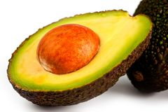 Avocado bright and juicy shot close-up on a white background stock images