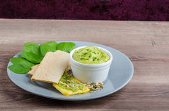 Avocado-Buttermilk Green Goddess Dip. With fresh herbs and  Crispbread with a mixture of seeds Stock Images