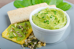 Avocado-Buttermilk Green Goddess Dip. With fresh herbs and  Crispbread with a mixture of seeds Royalty Free Stock Image