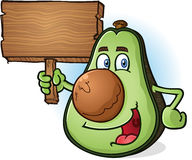 Avocado Cartoon Character Holding Wooden Sign. A smiling happy avocado cartoon character holding a blank wooden sign Stock Images