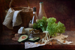 Avocado, cheese, nuts, leaves of green salad and wine Stock Photography