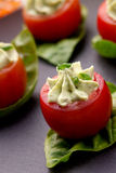 Avocado Cheese Stuffed Tomatoes. Royalty Free Stock Photo