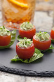 Avocado Cheese Stuffed Tomatoes. Royalty Free Stock Photography