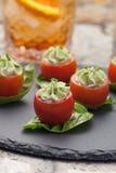 Avocado Cheese Stuffed Tomatoes. Royalty Free Stock Photography