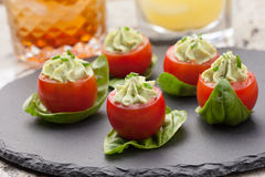 Avocado Cheese Stuffed Tomatoes. Stock Images
