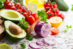 Avocado, cherry tomatoes, citrus and fresh herbs royalty free stock image