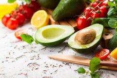 Avocado, cherry tomatoes, citrus and fresh herbs royalty free stock photo