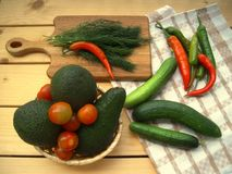 Avocado, cherry tomatoes, cucumbers, hot pepper and dill. Stock Photo