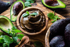 Avocado chocolate mousse in olive wooden bowl Royalty Free Stock Images