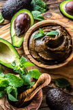 Avocado chocolate mousse in olive wooden bowl Royalty Free Stock Photography