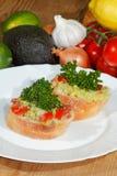 Avocado, ciabatta, Guacamole, Tomate, Zitrone, Zwiebel, Knoblauch Lizenzfreie Stockbilder