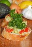 Avocado, ciabatta, guacamole,  tomato, lemon, onion, garlic Royalty Free Stock Images