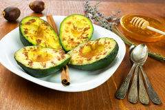 Avocado with cinnamon and honey Stock Photos