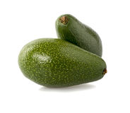 Avocado in closeup. Two green avocado on white background Royalty Free Stock Photos