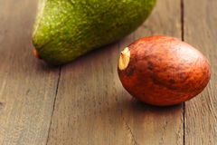 Avocado core on brown wooden old table Stock Photo