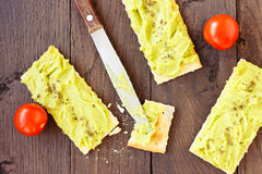 Avocado cream,biscuits and small tomatoes Royalty Free Stock Image