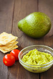 Avocado cream,biscuits and small tomatoes Royalty Free Stock Photos