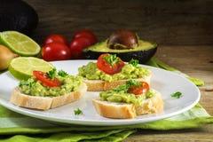Avocado cream or guacamole on baguette sandwiches freshly prepar Royalty Free Stock Images