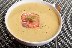 Avocado cream soup with smoked salmon Royalty Free Stock Photo