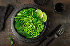 Avocado, cucumber, broccoli, asparagus and sweet peas salad, fre Royalty Free Stock Photo