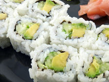 Avocado and Cucumber Roll. Avocado and Cucumber Sushi Roll with ginger.  Vegetarian Japanese food Stock Photos