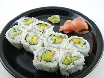 Avocado and Cucumber Roll. Avocado and Cucumber Sushi Roll with ginger.  Vegetarian Japanese food Royalty Free Stock Image